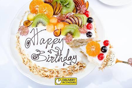 Order Tropical Fresh Fruit Cake - 1 Kg (Eggless) online from FreshMenu>